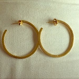 Inside out gold hoops with cubic zirconia.